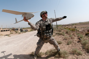 U.S. Army 1st Lt. Steven Rose launches an RQ-11 Raven unmanned aerial vehicle near a new highway bridge project along the Euphrates River north of Al Taqqadum, Iraq, on Oct. 9, 2009. Rose is assigned to Charlie Company, 1st Battalion, 504th Parachute Infantry Regiment, 1st Brigade Combat Team, 82nd Airborne Division which is assisting Iraqi police in providing security for the work site. DoD photo by Spc. Michael J. MacLeod, U.S. Army. (Released)