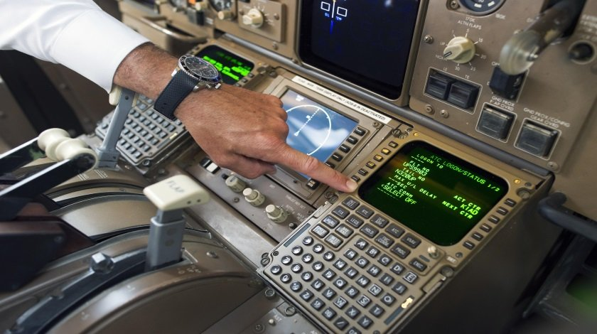 UPS Capt. Christian Kast points to the Data Communications Data Comm technology in the cockpit of an UPS Boeing 767-300F aircraft at Dulles International Airport Air Traffic Control Tower in Sterling, Va., Tuesday, Sept. 27, 2016. Data Comm gives air traffic controllers and pilots the ability to transmit flight plans, clearances, instructions, advisories, flight crew requests, and reports via a digital message service. (AP Photo/Cliff Owen) ORG XMIT: VACO103
